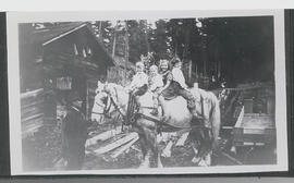 Alaric children and Norm Barr sitting on a Workhorse