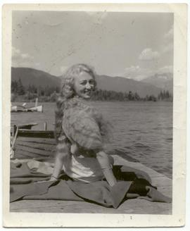 Joan Nolet on a dock, [Alta Lake]