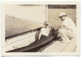 Alex Philip on the dock with woman in sailboat