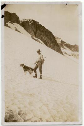 Alex Philip with his dog, Skookum
