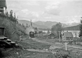 Train on Pacific Great Eastern Railway approaching the section house on Alta Lake
