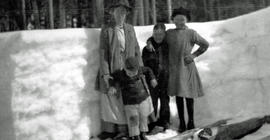 Jardine / Neiland family in front of a snowbank