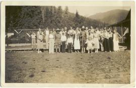 Group photograph in front of the tennis courts