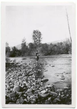 Myrtle Philip fishing in Rocky Creek bed