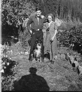 Bob Jardine & Lizzie Neiland with Tweed the dog in the garden at 34 1/2 Mile