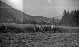 Jardine / Neiland family in a partially harvested field
