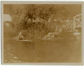 Boys in canoes on Rainbow Creek