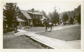 Horseback rider outside Rainbow Lodge