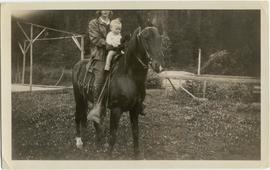 David Esworthy as a baby on horseback