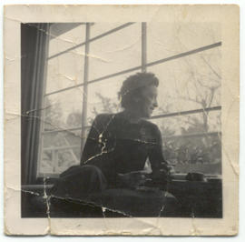 Pat Prowd at a window