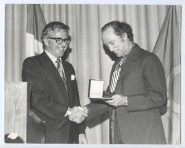 Pierre Trudeau Shaking Hands with Unidentified Man