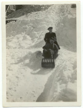 Reggie Shurie, Jimmy Lobb and Myrtle Philip tobogganing