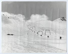 Powder with Ski Tracks and Skiers on the T-bar