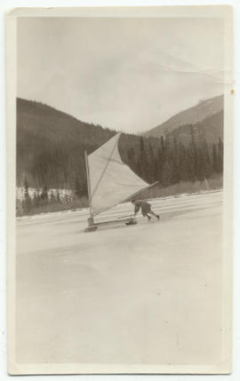 Man pushing an ice boat