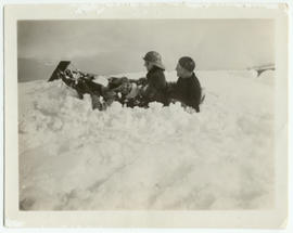 Myrtle Philip and two friends falling off a toboggan