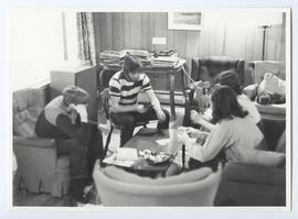 Group Playing Cards in Whistler Mountain Youth Hostel