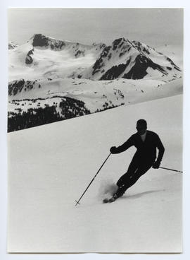 Male Skier with Peaks in Background