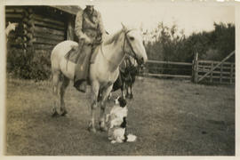Horseback rider and Binkie the dog